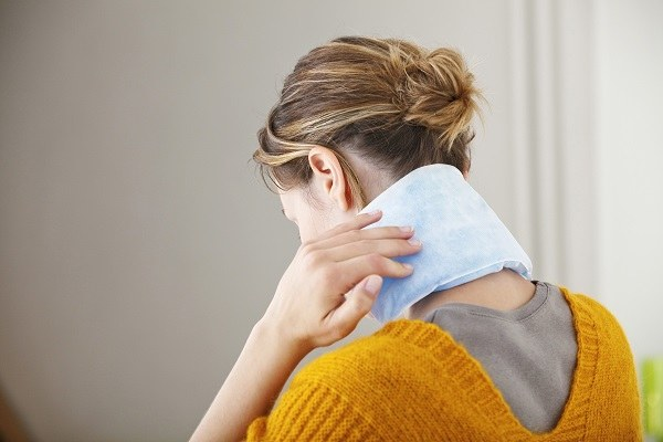women with heating pad