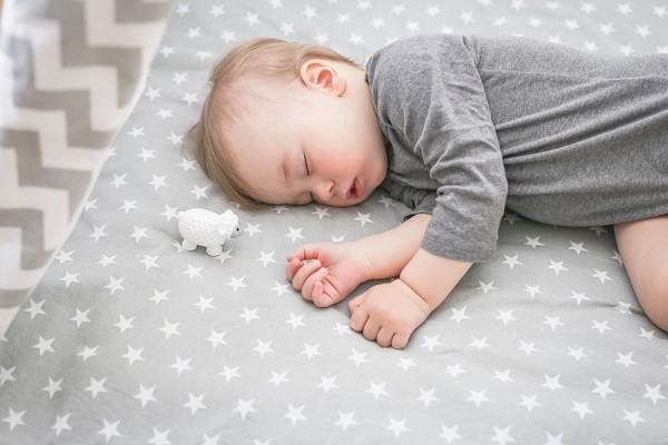 sleeping baby on the mattress
