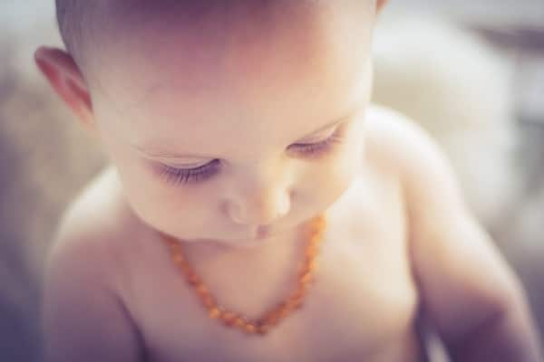 baby with teething necklace