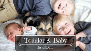 Toddler & baby in a room